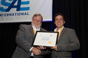 Award winner Erick Scarpone (R) and Thomas Stover, SAE Commercial Vehicle Sector Vice President (L).