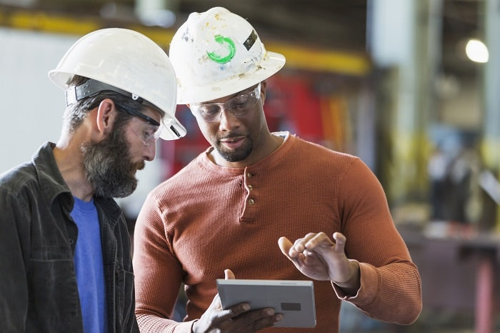 Two workers with a digital tablet